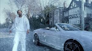 Drake dressed in all-white in the snow